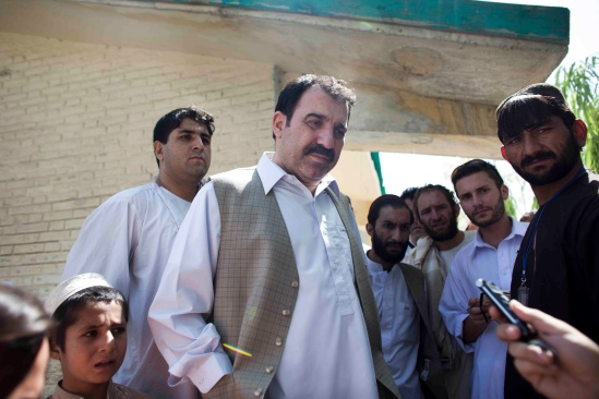Ahmed Wali Karzai makes a statement immediately after casting his vote at a polling booth in Kandahar City on August 20, 2009. Julius Cavendish second from right (Jonathan Saruk)
